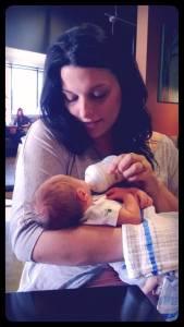 A photo of me feeding my son raw milk formula