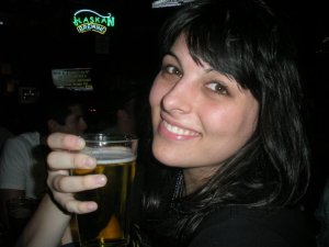 A photo of me drinking a beer during my college days in Chico